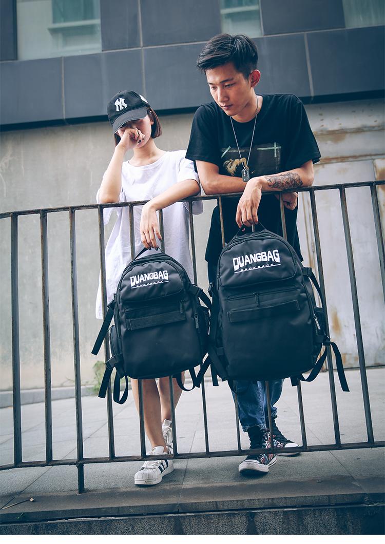 กระเป๋าเป้สะพายหลังสารพัดประโยชน์ สวย ทน เท่ห์ คุณภาพชั้นนำเป็นที่ยอมรับระดับสากล new waterproof skateboard pack high-quality motorcycle nylon cloth casual fashion big backpack in Europe and America