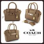 """กระเป๋าแฟชั่น สไตล์ Coach รุ่นขายดี วัสดุเกรดพรีเมี่ยม PU สีด้าน งานทรงสวย ขนาดกะทัดรัด กำลังสวย ด้านหน้า ตกแต่ง สายคาดพร้อมตัวบิดอะไหล่สีเงาทอง สวยงาม ด้านหลังมีซิปซ่อนขนาดเล็ก มีสายห้อยป้าย ปั๊มโลโก้ มีสายสะพายไหล่ เส้นยาวปรับได้ ขนาดกว้าง (10)"""" ×"""